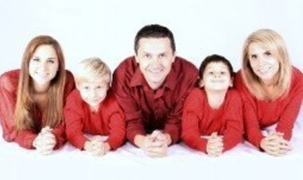 Homepage portrait of happy family on white background